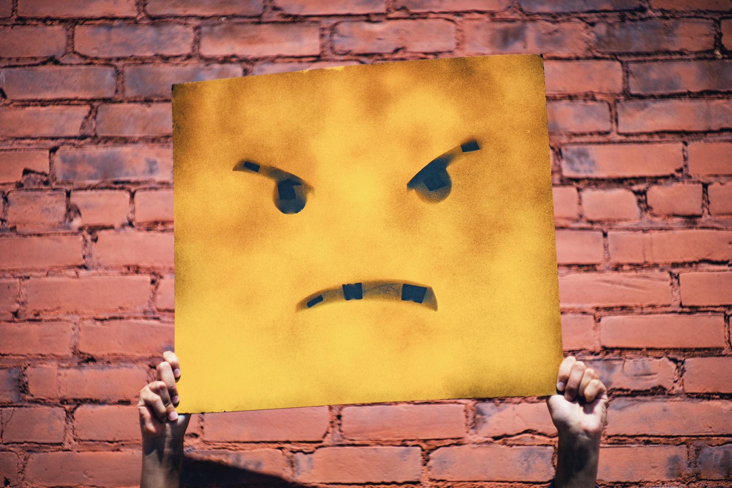 Frown Face Emoji Sign